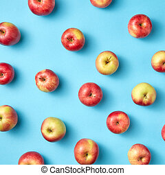 Fruit apples pattern on blue.