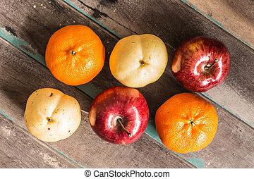fruit arranged on wood.