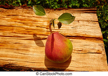 Fresh organic pear on old wood.