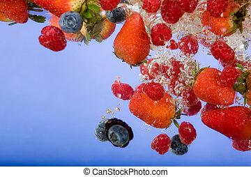 Fruit Background - Fruit splashing in water background -...