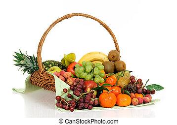 Fruit basket - Seasonal varied tropical fruit basket. Studio...