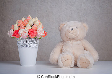 Fruit bouquet decoration with teddy bear toy on the table