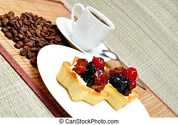 Fruit cake and a cup of coffee - Fruit cake on a plate and a...