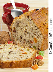Fruit cake on a wooden pad
