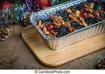Fruit cake on wooden board