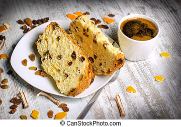 Fruit cake with raisins, candied fruit and coffee