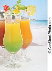 Fruit cocktails on a beach
