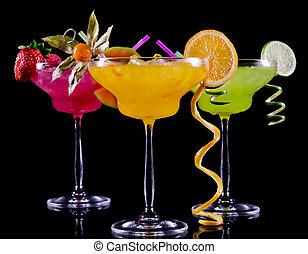 Fruit cocktails on black background
