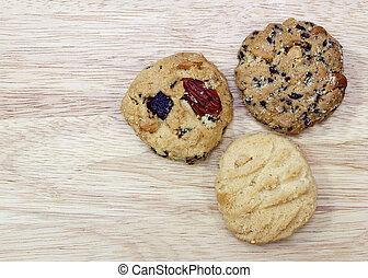 fruit cookies on wood background