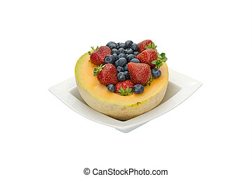 Fruit desert of berries and cantaloupe in white bowl