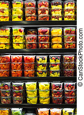 Fruit Display - Assortment of cut fruit in containers on...