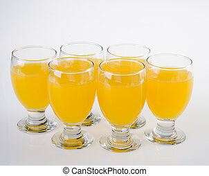 Fruit drink in glasses on white