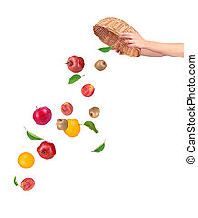 Fruit falling from basket isolated on a white background
