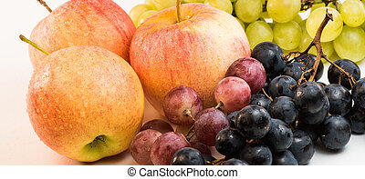 Fruit grapes, apples, on a white background