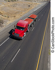 A shot from above a California freeway and local fruit transporting activities