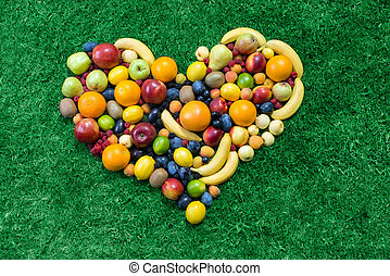 Fruit heart lying on grass