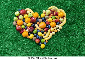 Fruit heart lying on grass