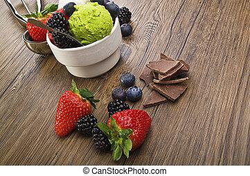 fruit ice cream close up on wood table