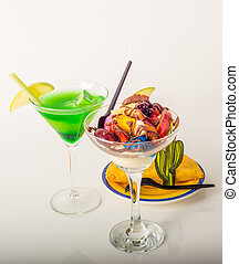 Fruit ice cream, decorated with fresh fruit, chocolate covered, green drink, martini glass, jamaican food