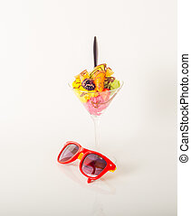 Fruit ice cream, decorated with fresh fruit, chocolate covered, martini glass, sunglasses