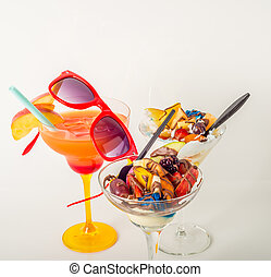 Fruit ice cream, decorated with fresh fruit, chocolate covered, orange drink, margarita glass
