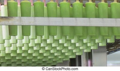 Fruit ice cream in green color. Ice cream factory. Automated...
