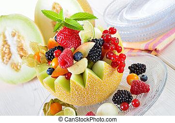 Fruit in a melon - Fruit in season, filled in a netted melon