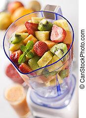 Fruit in blender - Mixed fruit in blender close up shoot
