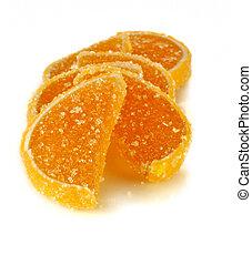 fruit jellies in form citrus lobules in orange tones