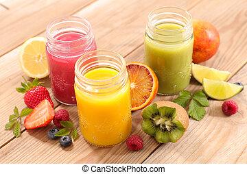 fruit juice- berry fruit, orange, kiwi, smoothie and straw