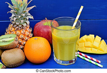 Fruit juice in a glass on wooden table