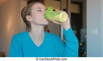 Fruit juice raw food - healthy eating woman drinks smoothie