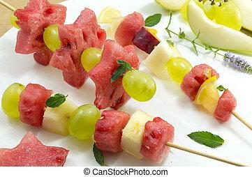 Fruit kebab. Fruit salad arranged like kebab.