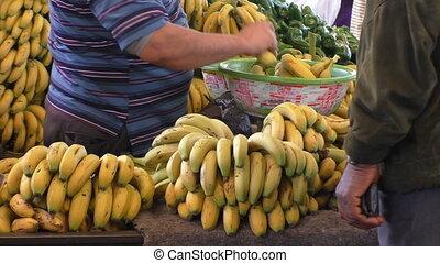 Fruit market vendor selling bananas