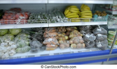 Fruit market with various colorful fresh fruits and vegetables. shelf in the supermarket with organic food