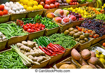 Fruit market with various colorful fresh fruits and ...