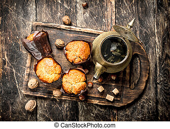 Fruit muffins with hot aromatic tea.