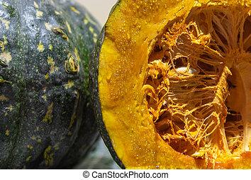 Fruit of caboti? strawberry (Cucurbita maxima x Cucurbita moschata) in natura and kept in half