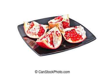 Fruit of pomegranate on a plate