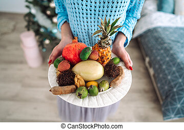 Fruit on a plate in the hands