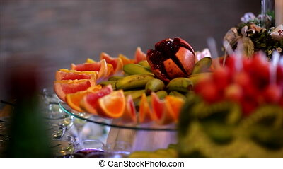 fruit on the buffet table - grapefruit, watermelon, banana,...