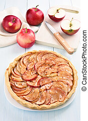Fruit pie with fresh apples on wooden table