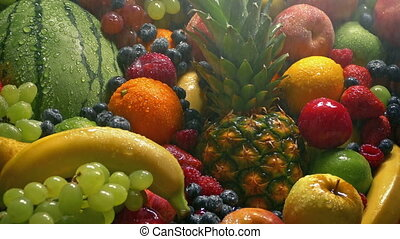 Fruit Pile In Fine Water Spray - Colorful spread of ripe...
