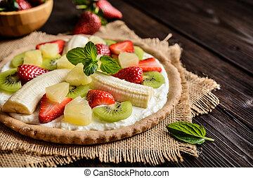 Fruit pizza with banana, kiwi, strawberry, pineapple