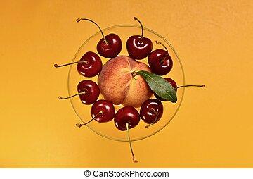 Fruit platter in a vase on top.