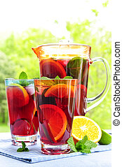 Fruit punch in pitcher and glasses - Refreshing fruit punch ...