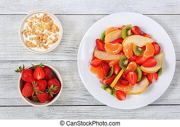 fruit salad and yogurt with muesli