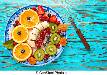 Fruit salad breakfast orange banana kiwi berries ow...