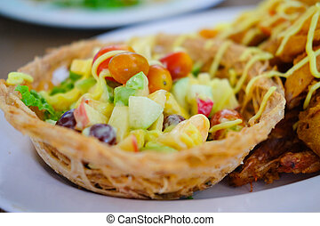 Fruit salad cream in taro basket