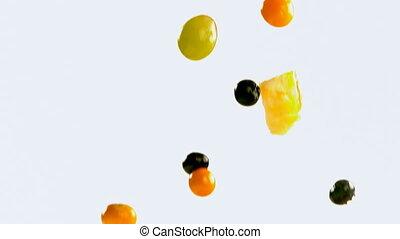 Fruit salad falling against white background 4k - Close-up...